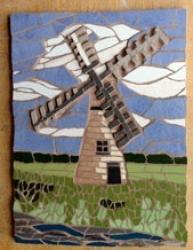 A mosaic windmill wall hanging
