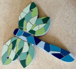Mosaic dragonfly with green wings and blue body - an exterior/interior wall hanging