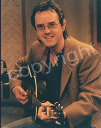 Signed photo 1 Woody with guitar